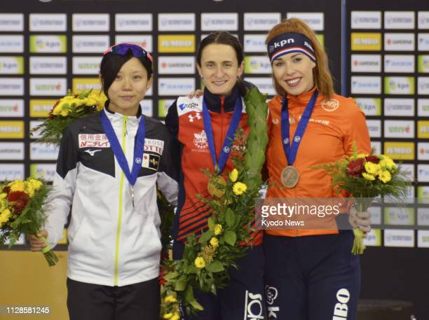 Martina Sablikova of the Czech Republic poses at the medal ceremony after winning the women's overall title at the World Allround Speed Skating...