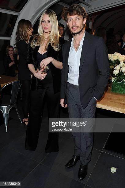 Martina Stella and Giorgio Pasotti attend Lacoste 80th Anniversary cocktail party at La Rinascente on March 21 2013 in Milan Italy