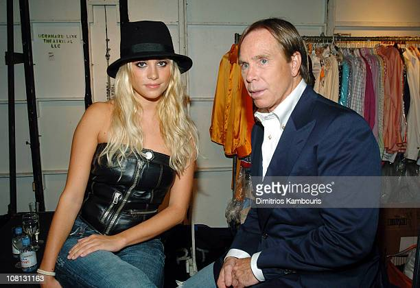 Martina Stella and Tommy Hilfiger during Olympus Fashion Week Spring 2005 Tommy Hilfiger Backstage at Theater Tent Bryant Park in New York City New...