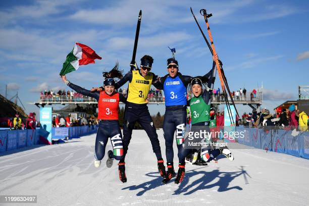 Martina Trabucchi , Nicolo Betemps, Marco Barale and Linda Zingerle of Italy celebrate after winning in Mixed Relay in biathlon during day 6 of the...