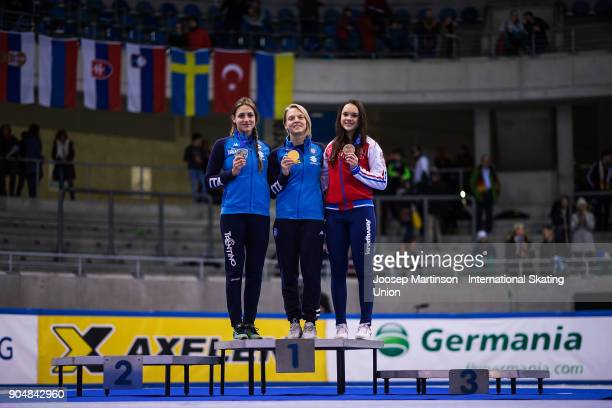 Martina Valcepina and Arianna Fontana of Italy and Sofia Prosvirnova of Russia pose in the overall classification medal ceremony during day three of...