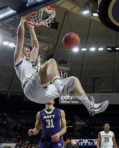 Martinas Geben of the Notre Dame Fighting Irish dunks the ball as Tom Lacey of the Navy Midshipmen looks on at Purcell Pavilion on November 16 2014...