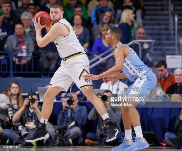 Martinas Geben of the Notre Dame Fighting Irish holds the ball against Garrison Brooks of the North Carolina Tar Heels at Purcell Pavilion on January...