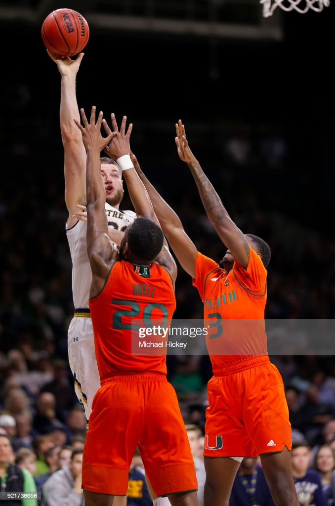 Martinas Geben #23 of the Notre Dame Fighting Irish shoots the ball against Dewan Huell #20 of the Miami (Fl) Hurricanes at Purcell Pavilion on February 19, 2018 in South Bend, Indiana.