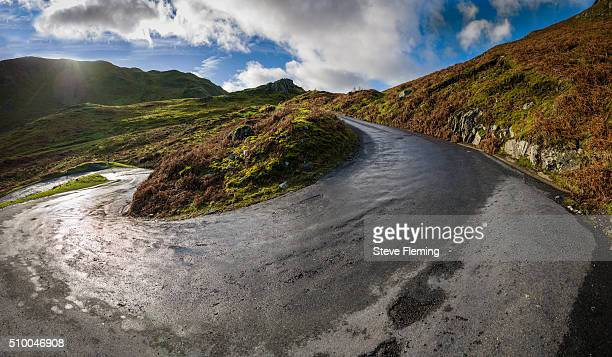 martindale road, cumbria, uk - hairpin curve stock photos and pictures