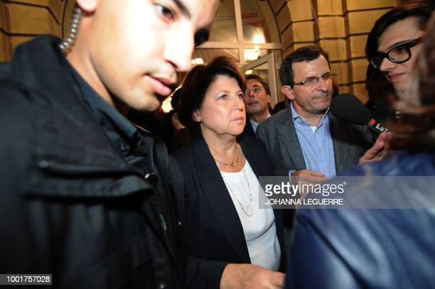 Martine Aubry candidate for the Socialist party's 2011 primary vote for France's 2012 presidential election leaves on October 9 2011 with her...