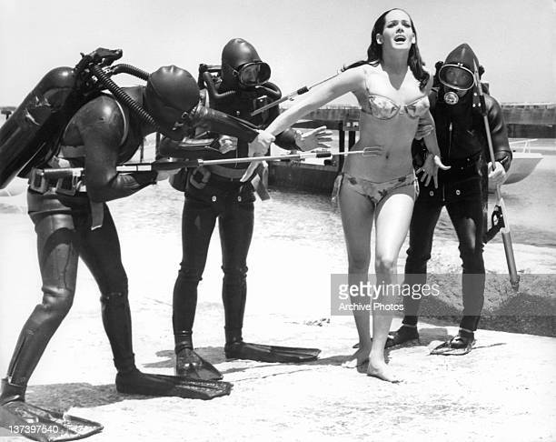 Martine Beswick has a group of spectre frogmen torturing her in a scene from the film 'Thunderball' 1965