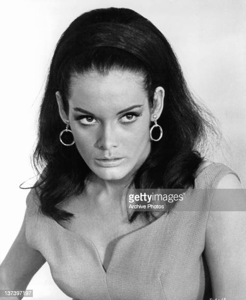 Martine Beswick looking serious wearing circular earrings in a scene from the film 'Thunderball' 1965