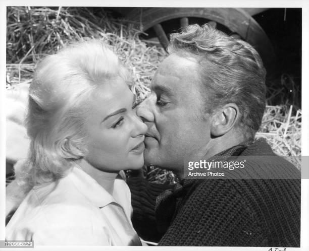 Martine Carol and Van Johnson kissing in a scene from the film 'Action Of The Tiger' 1951