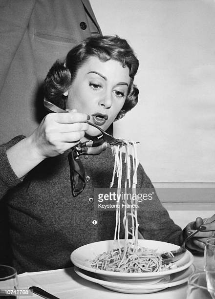 Martine Carol Eating Spaghetti In A Restaurant In Italy On March 1956