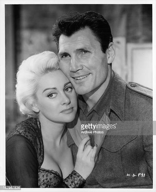 Martine Carol holding onto Jack Palance in a scene from the film 'Ten Seconds To Hell' 1959