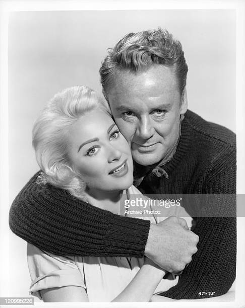 Martine Carol is embraced by Van Johnson in a scene from the film 'Action Of The Tiger' 1951