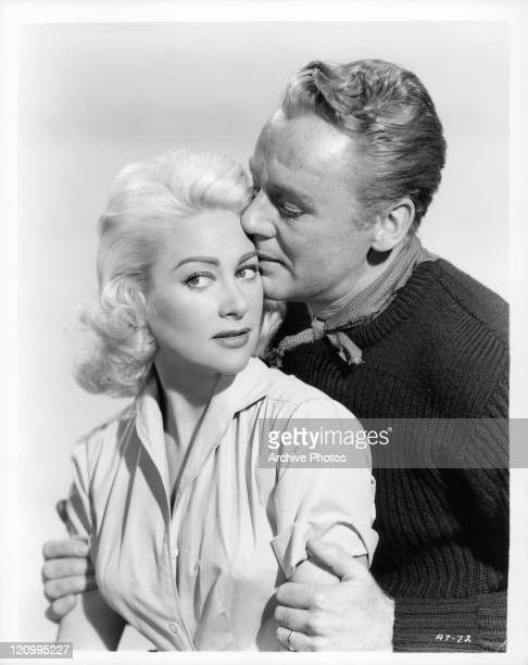 Martine Carol is kissed by Van Johnson in a scene from the film 'Action Of The Tiger' 1951