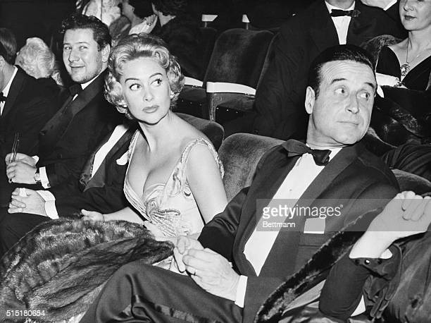 1955 Martine Carol is seated between her husband Christain Jacques and Peter Ustinov the British actor who costars with her in the film 'Lola Montes'...