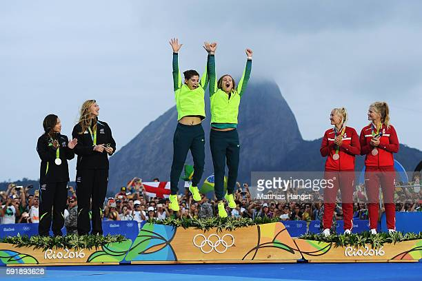 Martine Grael of Brazil and Kahena Kunze of Brazil celebrate winning gold in the Women's 49er FX class at the Marina da Gloria on Day 13 of the 2016...