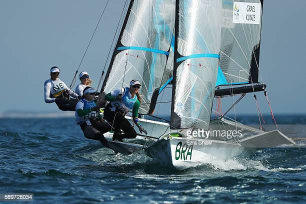 Martine Grael of Brazil and Kahena Kunze of Brazil compete in the Women's 49ers FX class on Day 10 of the Rio 2016 Olympic Games at the Marina da...