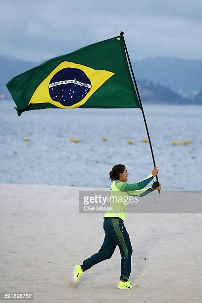 Martine Grael of Brazil celebrates winning gold in the Women's 49er FX class at the Marina da Gloria on Day 13 of the 2016 Rio Olympic Games on...