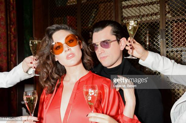 Martine Lervik and James D Kelly attend the second anniversary bash for eyewear label Moy Atelier by PerrierJouet at Ned's Club London on December 16...