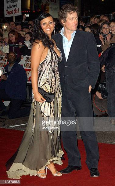 "Martine McCutcheon and Hugh Grant during ""Love Actually"" London Premiere - Arrivals at The Odeon Leicester Square in London, United Kingdom."