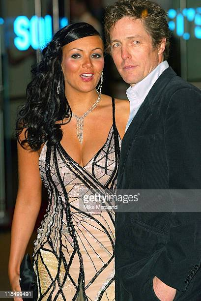 Martine McCutcheon and Hugh Grant during Love Actually London Premiere Arrivals at The Odeon Leicester Square in London United Kingdom