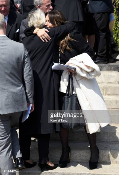 Martine McCutcheon is consoled by a mourner during the funeral of Dale Winton at the Old Church, 1 Marylebone Road on May 22, 2018 in London, England.