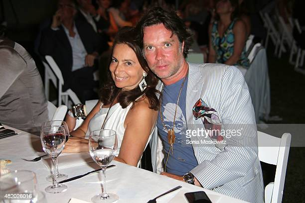 Martine Trink Rubenstein and Rufus Wainwright attend the 22nd Annual Summer Benefit and Auction at The Watermill Center 'Circus of Stillness' on July...