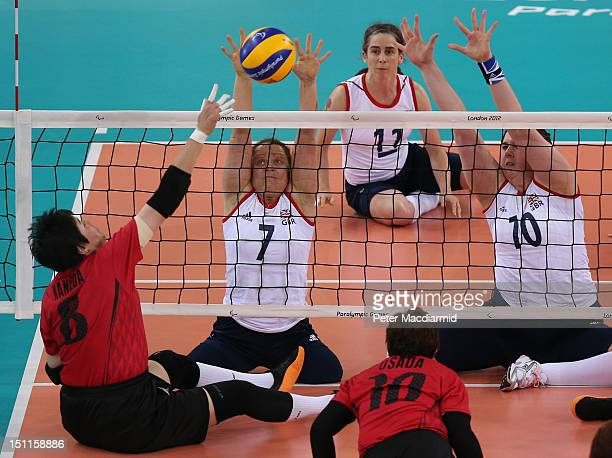 Martine Wright of Great Britain reaches up to block a shot from Noriko Kaneda of Japan during the Women's Sitting Volleyball Preliminary Round Pool A...