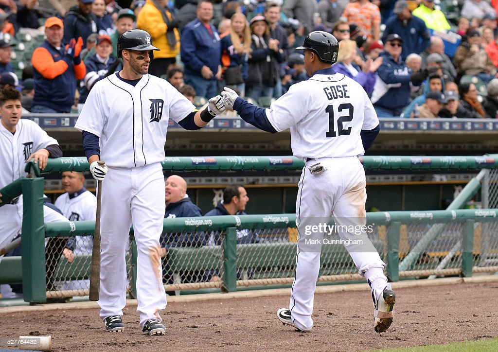 J.D. Martinez #28 and Anthony Gose #12 of the Detroit Tigers fist-bump during the game against the Oakland Athletics at Comerica Park on April 28, 2016 in Detroit, Michigan. The Tigers defeated the A's 7-3.