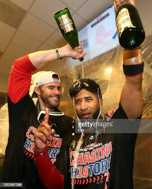 D Martinez and Eduardo Nunez of the Boston Red Sox celebrate in the locker room with his team after defeating the New York Yankees to win Game Four...