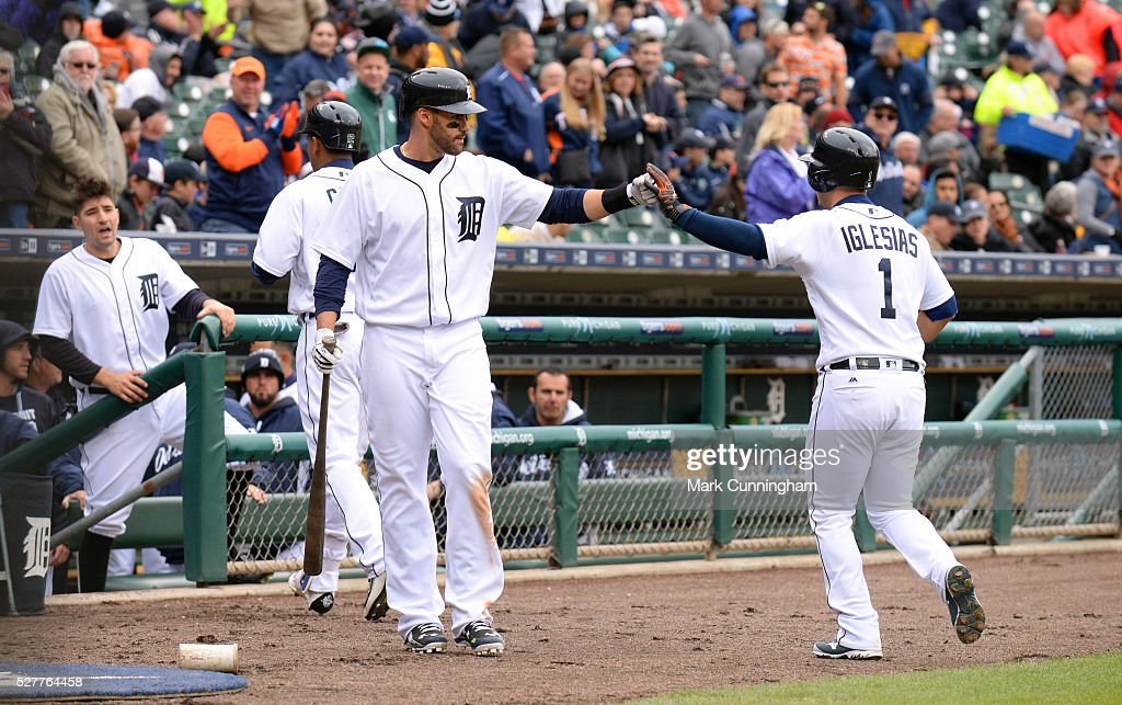 J.D. Martinez #28 and Jose Iglesias #1 of the Detroit Tigers fist-bump during the game against the Oakland Athletics at Comerica Park on April 28, 2016 in Detroit, Michigan. The Tigers defeated the A's 7-3.