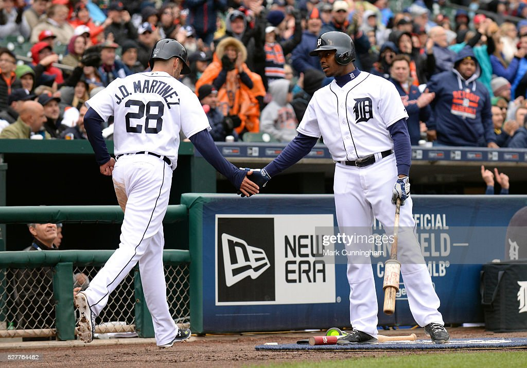 J.D. Martinez #28 and Justin Upton #8 of the Detroit Tigers shake hands during the game against the Oakland Athletics at Comerica Park on April 28, 2016 in Detroit, Michigan. The Tigers defeated the A's 7-3.