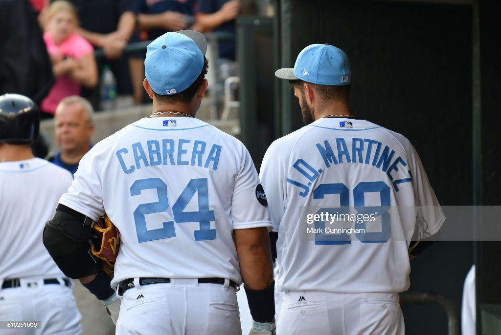 J.D. Martinez #28 and Miguel Cabrera #24 of the Detroit Tigers walk together in the dugout after the game against the Tampa Bay Rays while wearing a special blue jersey and hat for prostate cancer awareness on Father's Day Weekend at Comerica Park on June 17, 2017 in Detroit, Michigan. The Rays defeated the Tigers 3-2.