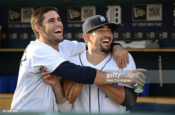 D Martinez and Nick Castellanos of the Detroit Tigers look on from the dugout and smile prior to the game against the Tampa Bay Rays at Comerica Park...