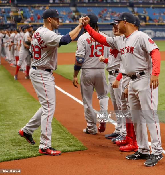 D Martinez greets Alex Cora of the Boston Red Sox during introductions prior to the game between the Boston Red Sox and the Tampa Bay Rays at...