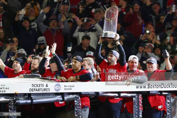 D Martinez of the 2018 World Series Champions Boston Red Sox holds the Commissioner's Trophy as the Red Sox are honored before the game between the...