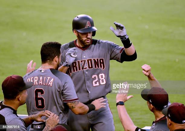 D Martinez of the Arizona Diamondbacks celebrates his second homerun of the game in the dugout to take 30 lead during the seventh inning against the...