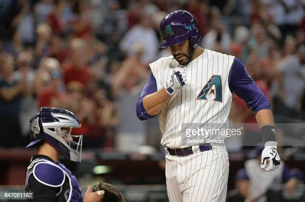 D Martinez of the Arizona Diamondbacks celebrates hitting a solo home run in the third inning of the MLB game against the Colorado Rockies against at...