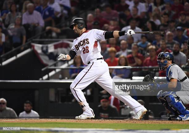 Martinez of the Arizona Diamondbacks follows through on a swing during game three of the National League Divisional Series against the Los Angeles...