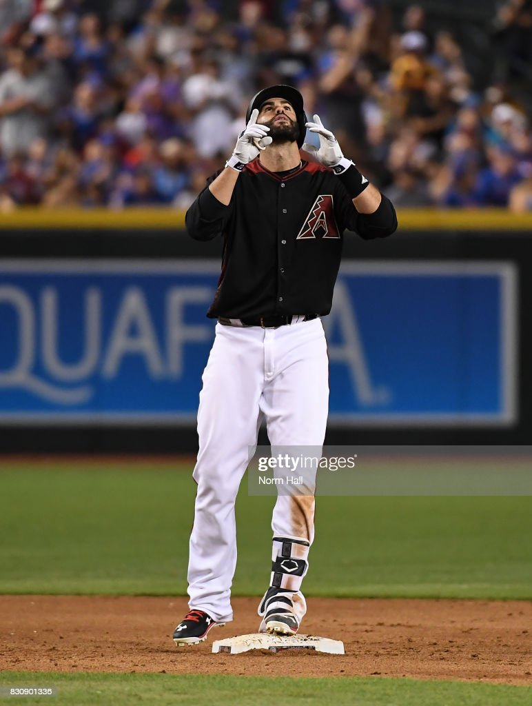 JD Martinez #28 of the Arizona Diamondbacks reacts while standing on second base after hitting an RBI double during the sixth inning against the Chicago Cubs at Chase Field on August 12, 2017 in Phoenix, Arizona.