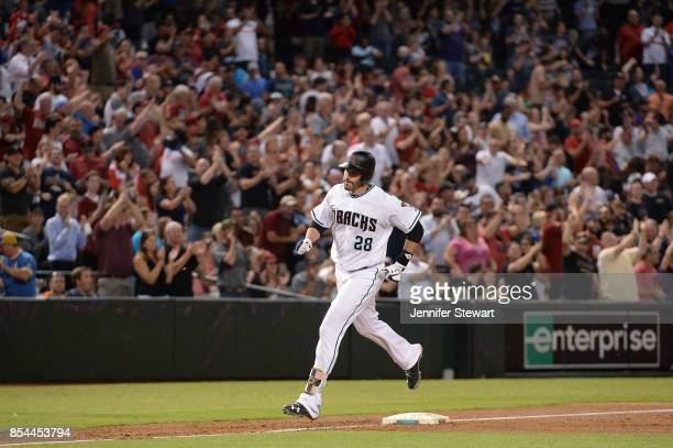 D Martinez of the Arizona Diamondbacks rounds third base after hitting a grand slam in the second inning of the MLB game against the San Francisco...
