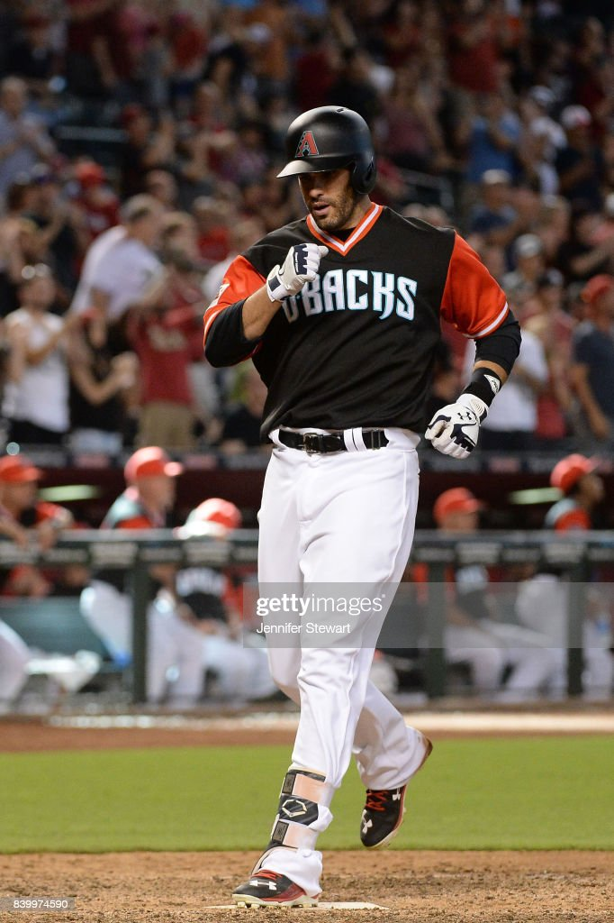 J.D. Martinez #28 of the Arizona Diamondbacks touches home plate after hitting a solo home run in the eighth inning against the San Francisco Giants at Chase Field on August 27, 2017 in Phoenix, Arizona.
