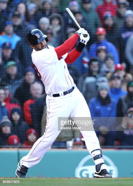D Martinez of the Boston Red Sox at bat during the eleventh inning of the Red Sox home opening game against the Tampa Bay Rays at Fenway Park on...