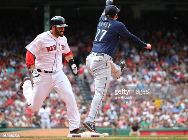 D Martinez of the Boston Red Sox beats the throw to Ryon Healy of the Seattle Mariners in the sixth inning at Fenway Park on June 24 2018 in Boston...