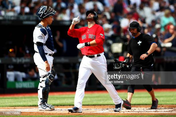 Martinez of the Boston Red Sox celebrates a home run during the MLB London Series game between Boston Red Sox and New York Yankees at London Stadium...