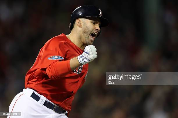 D Martinez of the Boston Red Sox celebrates a three run home run in the first inning against the New York Yankees during Game One of the American...