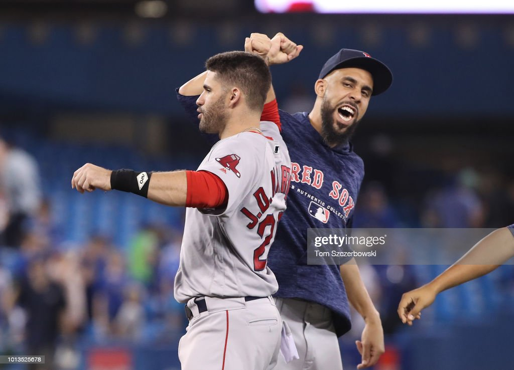 J.D. Martinez #28 of the Boston Red Sox celebrates a victory with David Price #24 after MLB game action against the Toronto Blue Jays at Rogers Centre on August 8, 2018 in Toronto, Canada.
