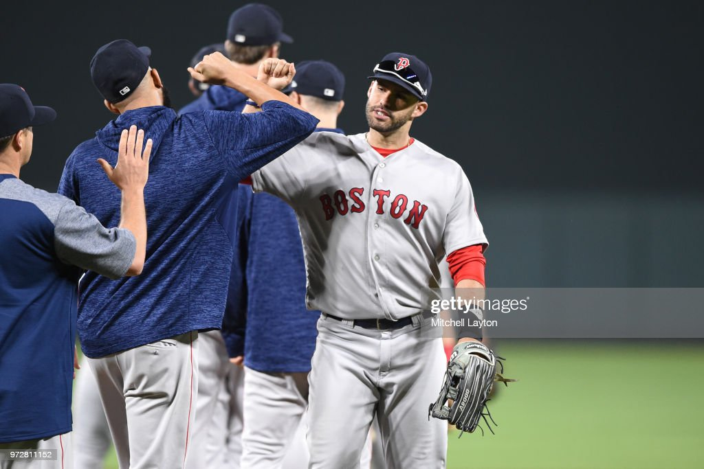 J.D. Martinez #28 of the Boston Red Sox celebrates a win with his teammates after a baseball game against the Boston Red Sox at Oriole Park at Camden Yards on June 12, 2018 in Baltimore, Maryland.