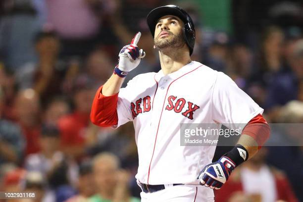 D Martinez of the Boston Red Sox celebrates after hitting a home run against the Toronto Blue Jays during the second inning at Fenway Park on...