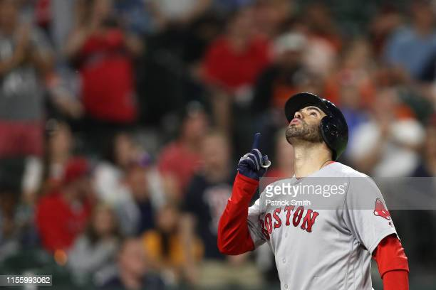 D Martinez of the Boston Red Sox celebrates after hitting a solo home run against the Baltimore Orioles during the fifth inning at Oriole Park at...