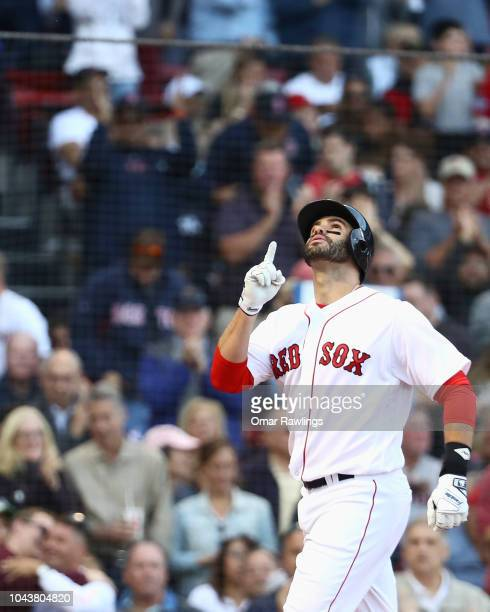 D Martinez of the Boston Red Sox celebrates after hitting a two RBI home run in the bottom of the fourth inning of the game against the New York...
